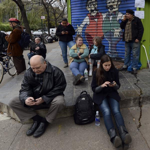 Residents of the East Village in New York City look for cellphone reception Nov. 1 after Hurricane Sandy wiped out power and some cell towers.