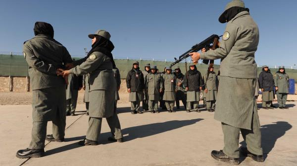 Afghan policewomen take part in a training exercise in the western province of Herat in 2011. Policewomen face frequent sexual harassment and assaults, often carried out by policemen, human rights groups say.