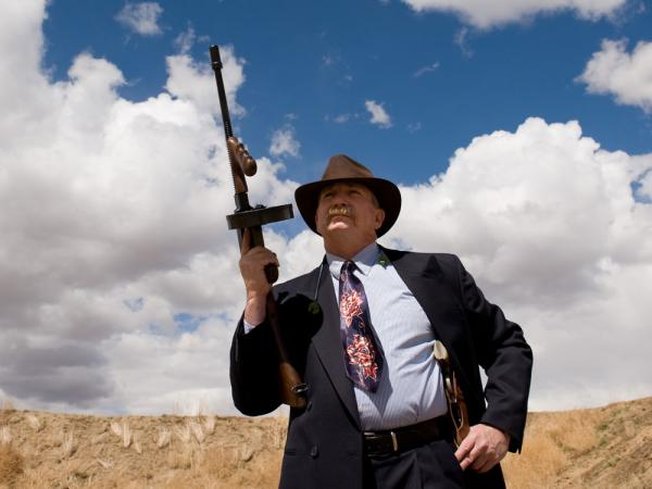 "Steve ""G-Man"" Fowler — a real-life police detective and ""good guy"" in both Zoot Shooters capers and cowboy action shooting competitions — poses with his Tommy gun."