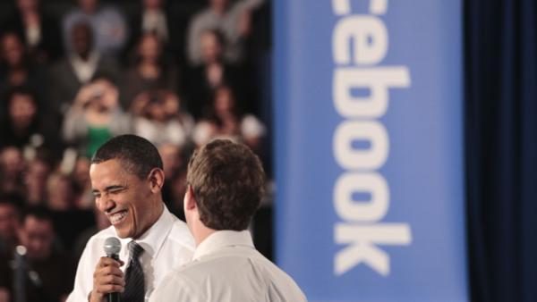 President Obama shares a laugh with Facebook CEO Mark Zuckerberg during a town hall meeting earlier this year on reducing the national debt.