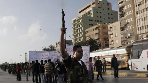 A Libyan rebel fires into the air while taking part in a military parade in Benghazi. Optimism in the rebel stronghold has turned to fear for some, as the crackle of shooting — celebratory, or to settle a score — has become a constant in the city.
