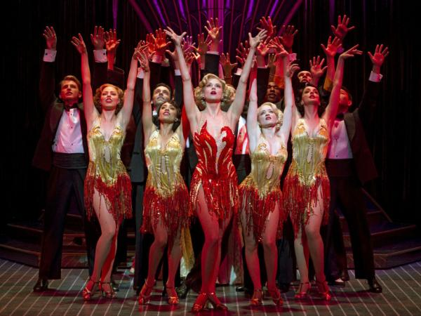 Sutton Foster (center) stars as Reno Sweeney, an evangelist turned nightclub singer, in this season's revival of <em>Anything Goes</em>.