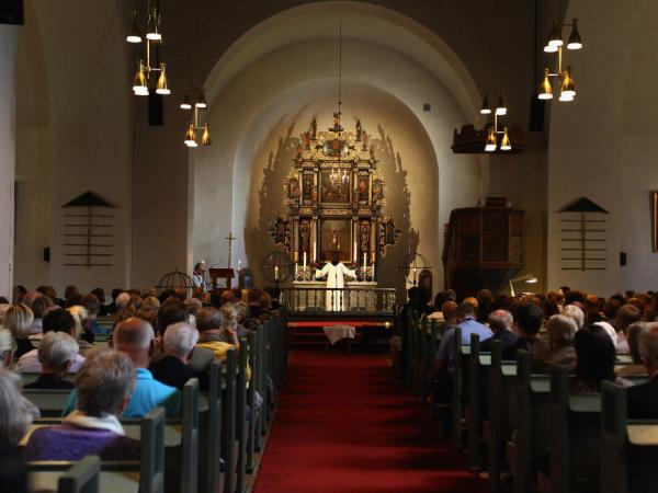 Mourners attend a memorial service at Smmerapen Norderhov kirke, following Friday's twin attacks in Oslo, Norway. At least 92 people were killed in the attacks.
