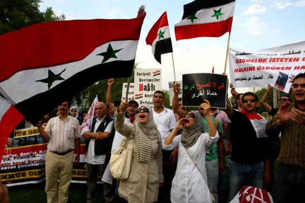 A pro-Islamic human rights group chants slogans as they call for the removal of Syrian president Bashar al Assad and his regime during a demonstration outside the Syrian Embassy in Ankara.