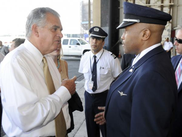 U.S. Transportation Secretary Ray LaHood (left) talks to American Airlines pilot Jesse Perkins after a news conference in New York on Monday.