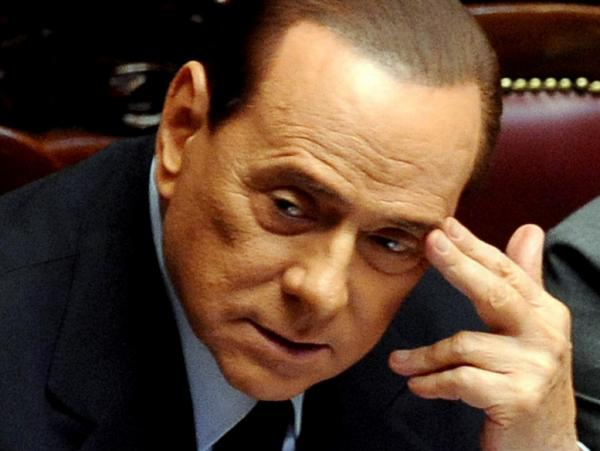 "Italian Prime Minister Silvio Berlusconi attends a debate on the Italian economic situation Wednesday at the Parliament in Rome. In a speech aimed at soothing concerns over a possible debt crisis, he said, ""We have solid economic fundamentals. Our banks have liquidity and are solvent."""