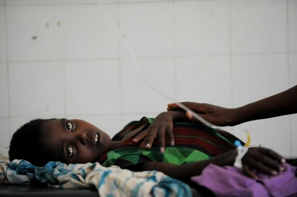 Bisharo Hurow, 10, lays on a cot at a hospital in Mogadishu while suffering from severe diarreah and vomiting on August 15. A cholera epidemic is spreading in famine-stricken Somalia.
