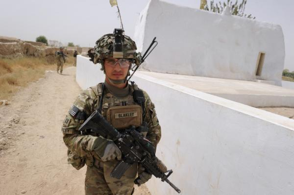 Captain Michael Blakley, company commander of Battle Co., 1-32 Infantry Battalion, 3rd Brigade Combat Team, accompanied by Afghan National Army soldiers leads the patrol at the Mullah Omar mosque in Sangsar village in Kandahar province, the heartland of Taliban in southern Afghanistan.