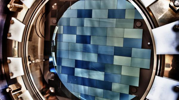 A look inside the Dark Energy Camera shows the 74 blue-tinged sensors that detect light. The camera will survey distant, faint galaxies to learn more about dark energy.
