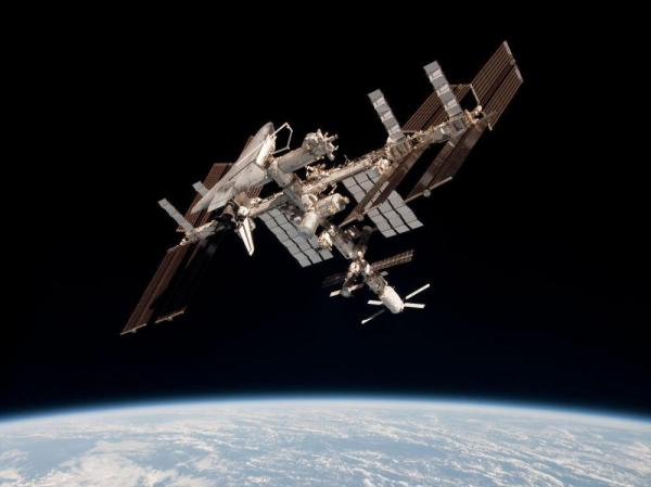 The International Space Station and the docked space shuttle Endeavour, flying at an altitude of approximately 220 miles, on May 23, 2011.