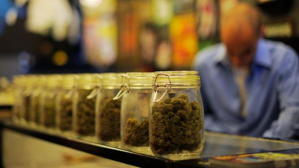 <p>Jars full of medical marijuana are seen at a medical marijuana dispensary in Los Angeles. U.S. attorneys sent letters telling more than a dozen of the shops to shut down.</p>