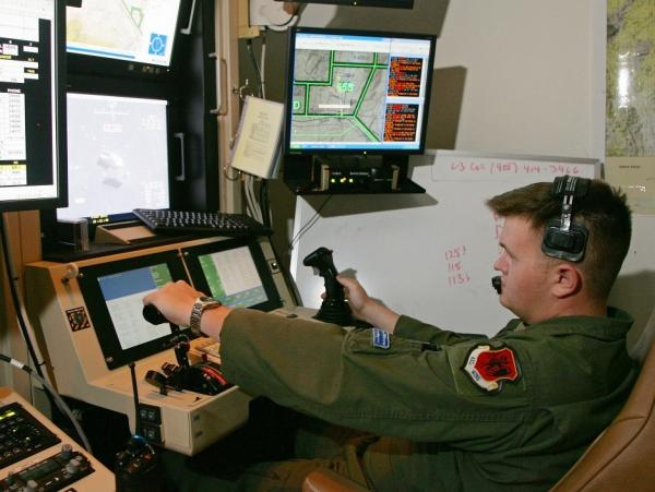 <p>Some of the computers controlling America's fleet of drone aircraft are reportedly infected by a persistent virus. In this file photo, a senior airman remotely operates an MQ-9 Reaper during a training mission at Creech Air Force Base in Indian Springs, Nev.</p>