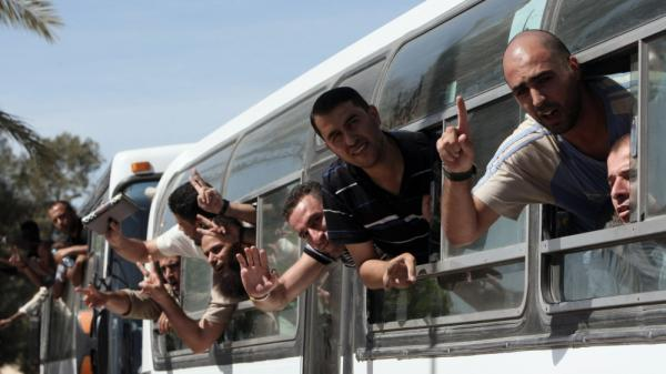 <p>Palestinian prisoners cross to the southern Gaza Strip from the Egyptian side of the Rafah border earlier today (Oct. 18, 2011) following their release from Israeli prisons.</p>
