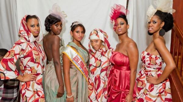 <p>Fashion designer Nailah Lymus (third from right) stands with models wearing her latest collection after a runway show.</p>