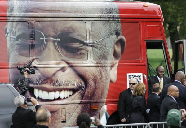 "<p>Republican presidential candidate Herman Cain steps out of his campaign bus to at a rally where he unveiled his ""Opportunity Zone"" economic plan in front of the Michigan Central Station, an abandoned train depot in Detroit. </p>"