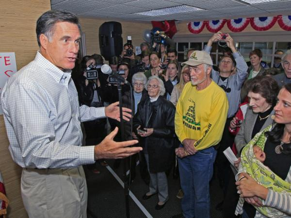 <p>Former Massachusetts Gov. Mitt Romney speaks to a group of supporters during a visit Tuesday to a GOP phone bank in Terrace Park, Ohio. </p>