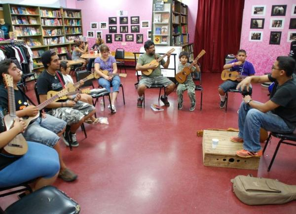 <p>Students learn the jarana in a Son Jarocho class at Tia Chucha's Centro Cultural & Bookstore in Sylmar, Los Angeles.</p>