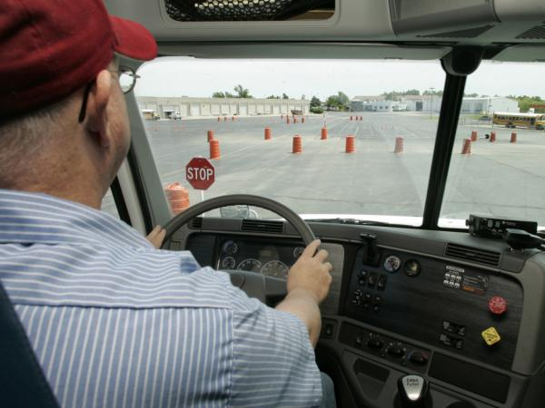 <p>Student Tommy Wood sits in the driver's seat of a training truck at Central Tech truck-driver training in Drumright, Okla.</p>