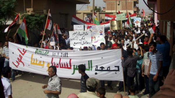 <p>Anti-government protesters march in the village of Amouda, Syria on Sept. 30. For many Syrians, the protests mark the first time they have taken part in anything resembling politics.</p>