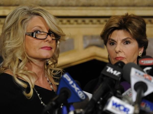 Sharon Bialek, left, aired her accusations against Herman Cain during a news conference Monday in New York City. The event was organized by lawyer Gloria Allred, right.