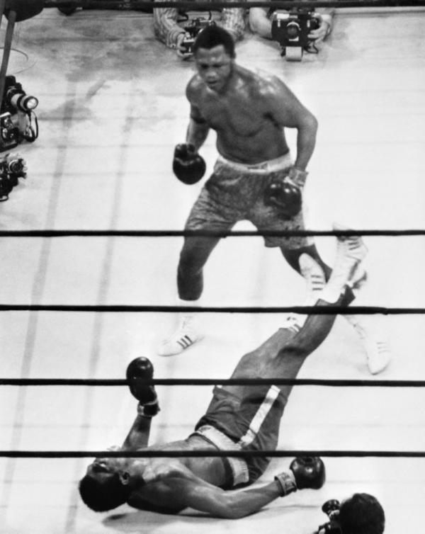 "Down goes Ali: In the ""Fight of the Century,"" on March 8, 1971, in Madison Square Garden, heavyweight champion Joe Frazier put Muhammad Ali on the canvas with a hard left hook. Frazier died Monday."