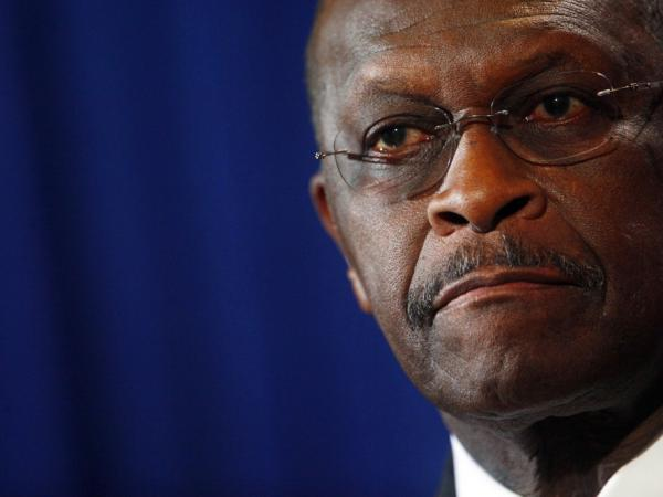 Herman Cain speaks at a press conference Tuesday in Scottsdale, Ariz., to rebut charges of sexual harassment.