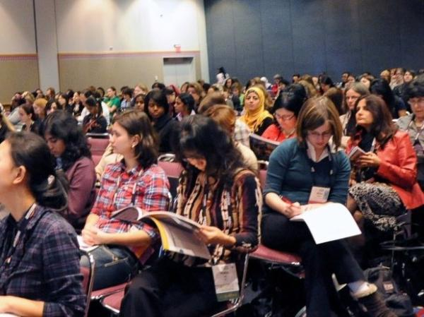 Women attend a talk on Wednesday at the Grace Hopper Celebration of Women in Computing in Portland, Ore. The conference offers mentoring and recruiting for women in technology fields.