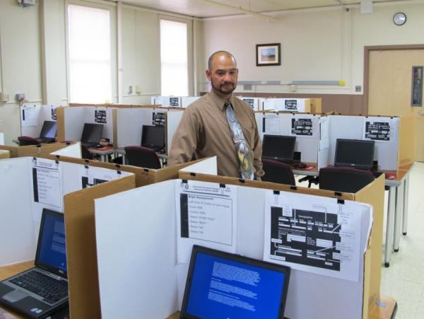 Felix Rios, a contractor with the Office of the Surgeon General, helps administer the ANAM test at Ft. Lewis, in Washington state.