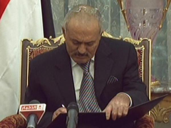 In this image from Saudi television, Yemeni President Ali Abdullah Saleh signs the Gulf Cooperation Council-sponsored transition deal Wednesday in the Saudi capital, Riyadh.
