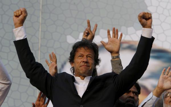 Former cricket star Imran Khan waves to supporters during a rally in Lahore, Pakistan, last month. Khan, who is campaigning to be prime minister, attracted a crowd of some 100,000 at the rally.