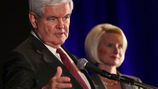 Newt Gingrich, shown with his wife, Callista Gingrich, attends a pre-debate rally sponsored by the Faith and Freedom Coalition earlier this year in Florida. The thrice-married former House speaker, who cheated on his first two wives and was punished by the House for ethical violations, is now outperforming family man Mitt Romney among Iowa's evangelicals.