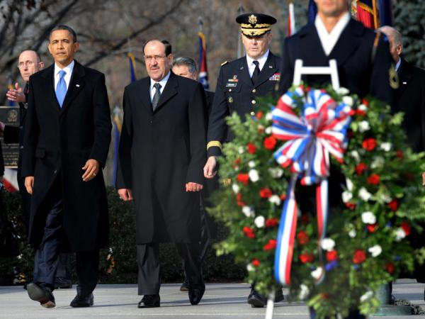 President Obama and Iraqi Prime Minister Nouri al-Maliki (second from left) participate in a wreath-laying ceremony at Arlington National Cemetery on Monday. Maliki was in Washington for talks ahead of the full withdrawal of U.S. troops from Iraq this month.