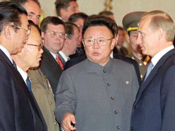 Kim Jong Il is seen here while introducing members of his delegation to Russian President Vladimir Putin.