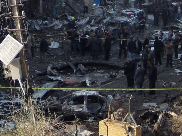 Iraqi security forces inspect a crater caused by a car bomb attack in the neighborhood of Karrada in Baghdad earlier today (Dec. 22, 2011). It was one in a wave of such bombings in the Iraqi capital today.