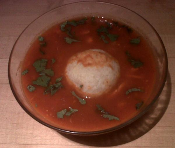 The<em> pozole</em> with matzo balls soup contains hints of chili, tomato and hominy.