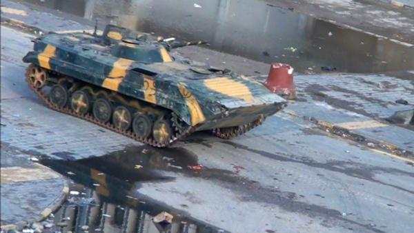 A Syrian tank driving through the city of Homs on Monday (Dec. 26, 2011).