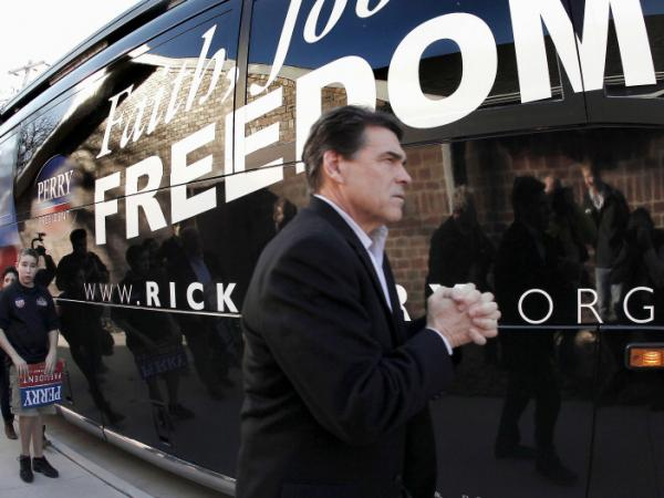 Texas Gov. Rick Perry walks to his bus after a campaign stop at the Glenn Miller Museum in Clarinda, Iowa on Dec. 27.