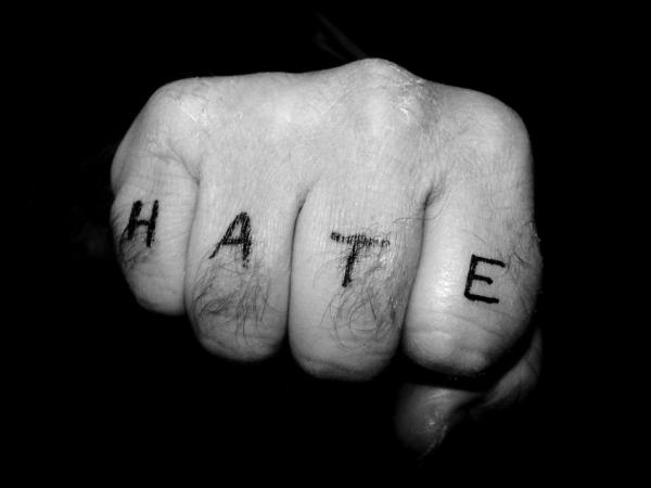 "A fist with the word ""hate"" on it."