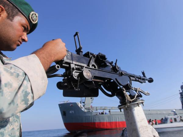 An Iranian Army soldier stood guard on a military speed boat during navy exercises in the Strait of Hormuz in southern Iran late last week.