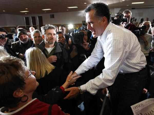 Former Massachusetts Gov. Mitt Romney greets voters after speaking at the Mississippi Valley Fairgrounds on Wednesday in Davenport, Iowa.