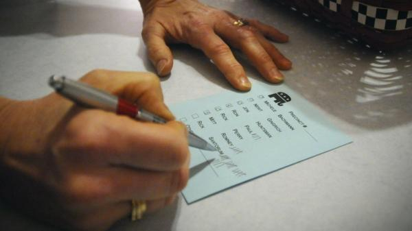 Barb Hansen tallies votes during a GOP caucus in precinct 42 near Smithland, Iowa, on Tuesday, Jan. 3, 2012.