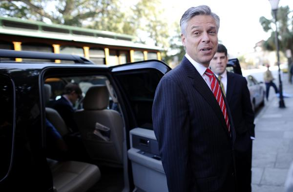Jon Huntsman greets people outside Virginia's restaurant in Charleston, South Carolina, on Sunday.
