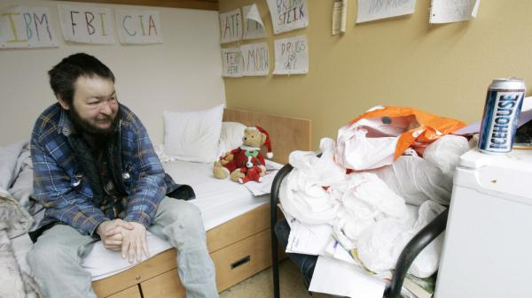 Brian Steik sits in his cubicle at a apartment building for homeless alcoholics in Seattle.