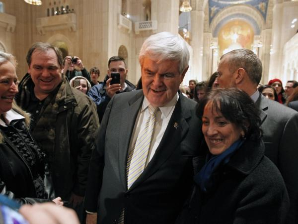 GOP presidential candidate and former House Speaker Newt Gingrich poses for a photo with supporters after Mass at the Basilica of the National Shrine in Washington, D.C., Sunday.