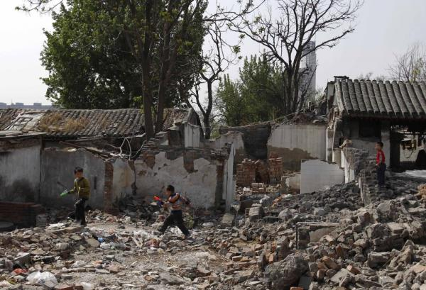 Children play in a traditional residential district in Beijing that is undergoing demolition, in April 2011. Despite public protest, historic and new homes are being destroyed all over the city to make way for development.