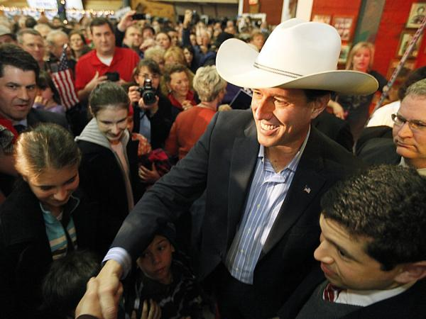 Rick Santorum shakes hands with supporters gathered at Fairview Farms in Plano, Texas on Feb. 8 in the wake of his three victories on Tuesday.