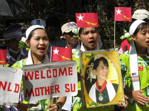 Ethnic Karen women welcome opposition leader Aung San Suu Kyi to War Thein Kha village. The area is in Kawhmu Township, which Suu Kyi is campaigning to represent in Myanmar's parliament.