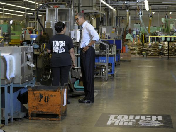 President Obama extolled U.S. manufacturing at Master Lock in Milwaukee as some experts said a return to the nation's industrial past may not be the best path forward.