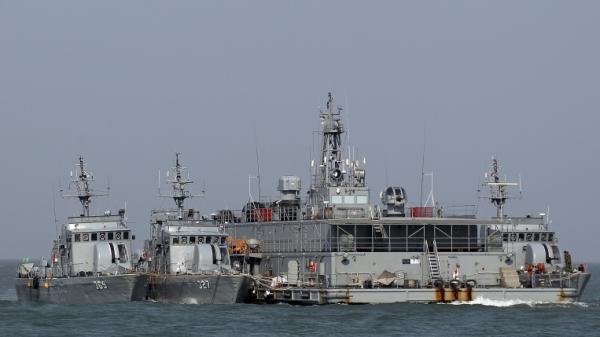 South Korean Navy ships dock at a floating base near Yeonpyong Island, close to its contested ocean border with North Korea Monday. South Korea conducted live-fire military drills from five islands, ignoring Pyongyang's threat to attack.