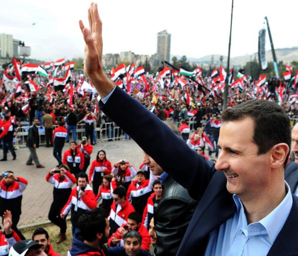 The U.S. has taken very different approaches to authoritarian rulers in recent years. President Obama has called for the ouster of Syrian President Bashar Assad, shown here in Damascus on Jan. 11, but has resisted calls for the use of U.S. military force against the Syrian regime.